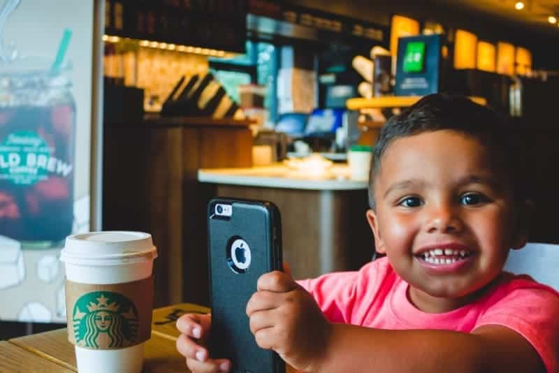 kid in coffee shop