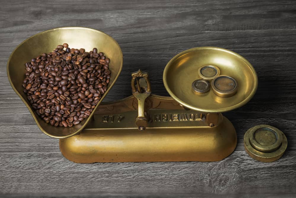 old retro scales on old wooden table with coffee beans