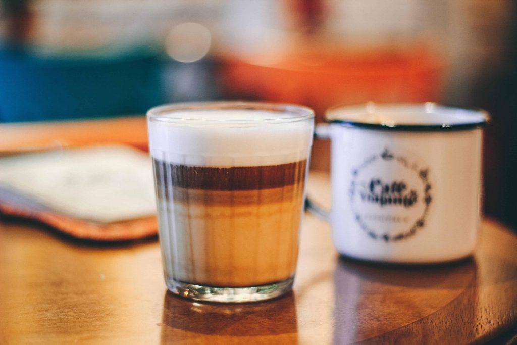 Latte Macchiato on table in glass