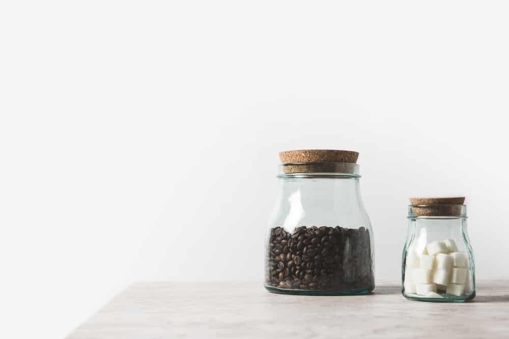 Coffee beans and marshmallows stored in glass jars