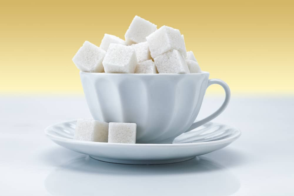 sugarcubes filling a coffee cup