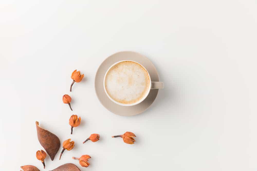 flat white coffee on white background with orange flowers