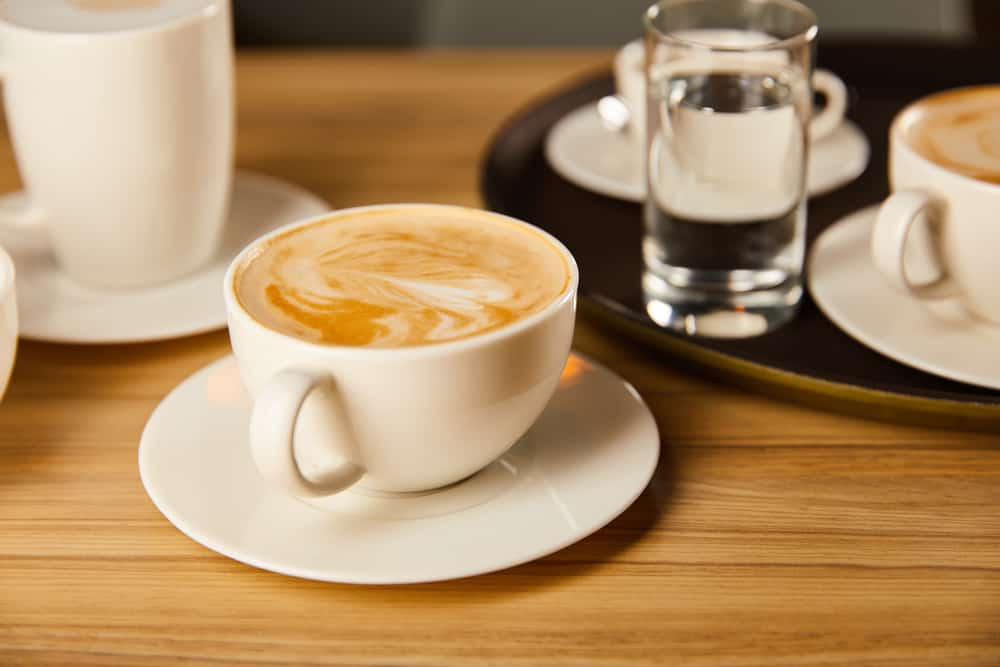 closeup of cappuccino on a wooden table
